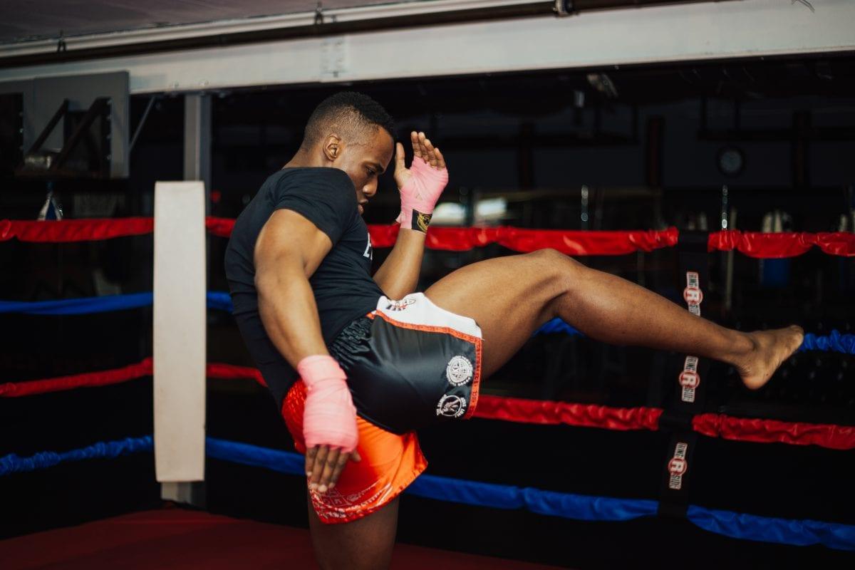 a man kickboxing