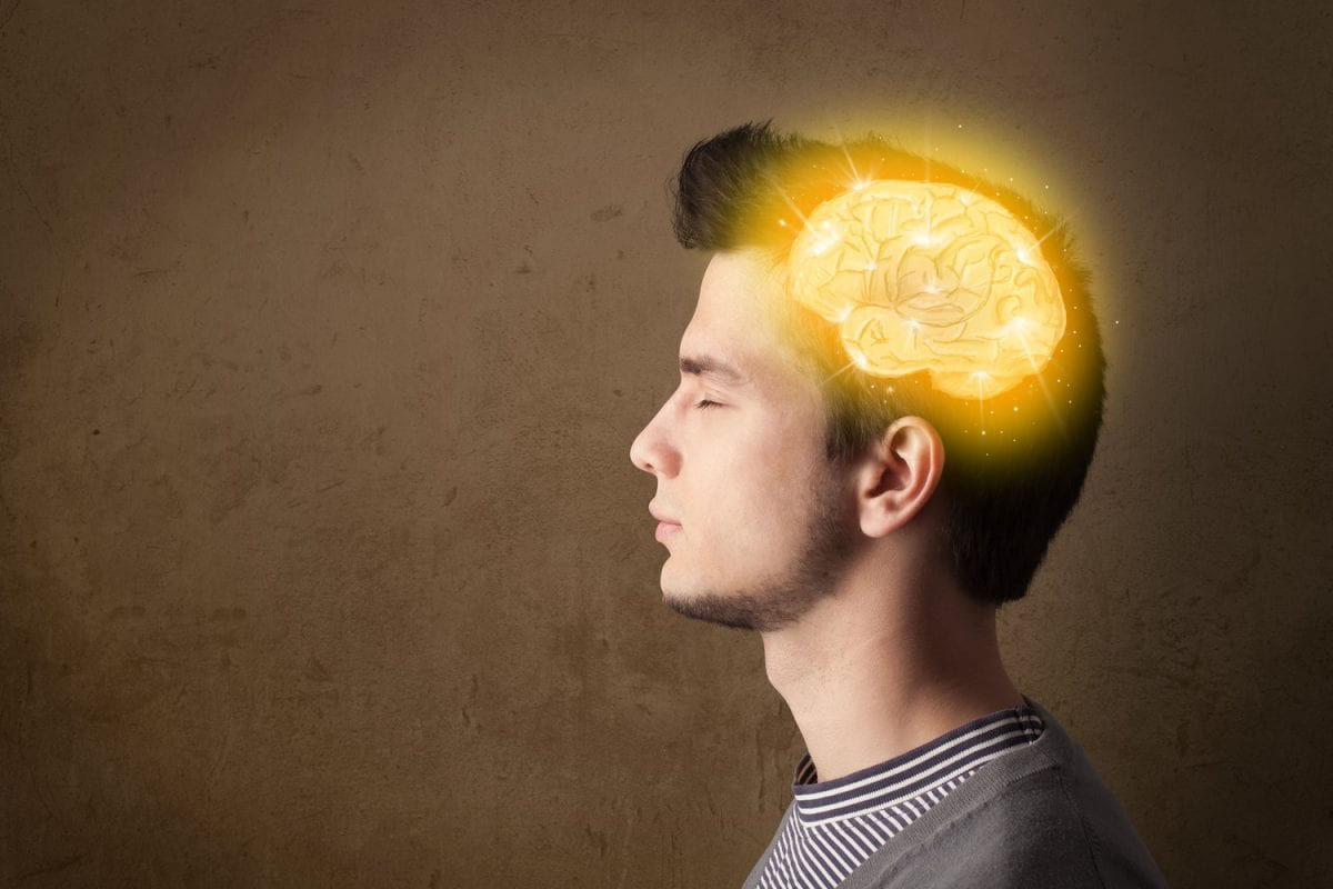 Young man thinking with glowing brain illustration