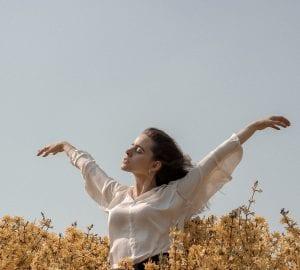 a woman in a flower field