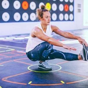 a woman doing a pistol squat