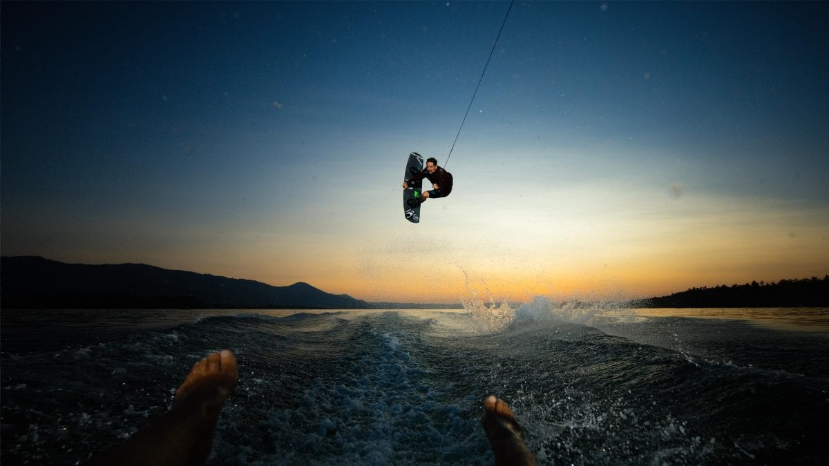 a person wakeboarding on the lake