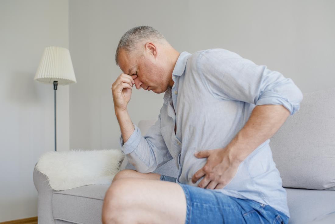 a man with an upset stomach