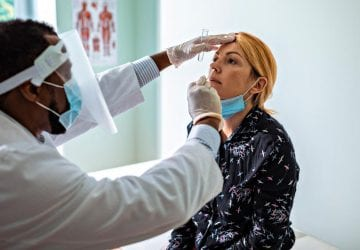 a woman getting a Covid test