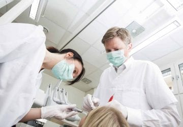 dentists working with a patient