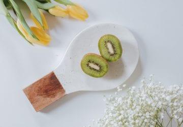 a sliced kiwi on a tray