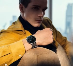 a man relaxing wearing a huawei watch