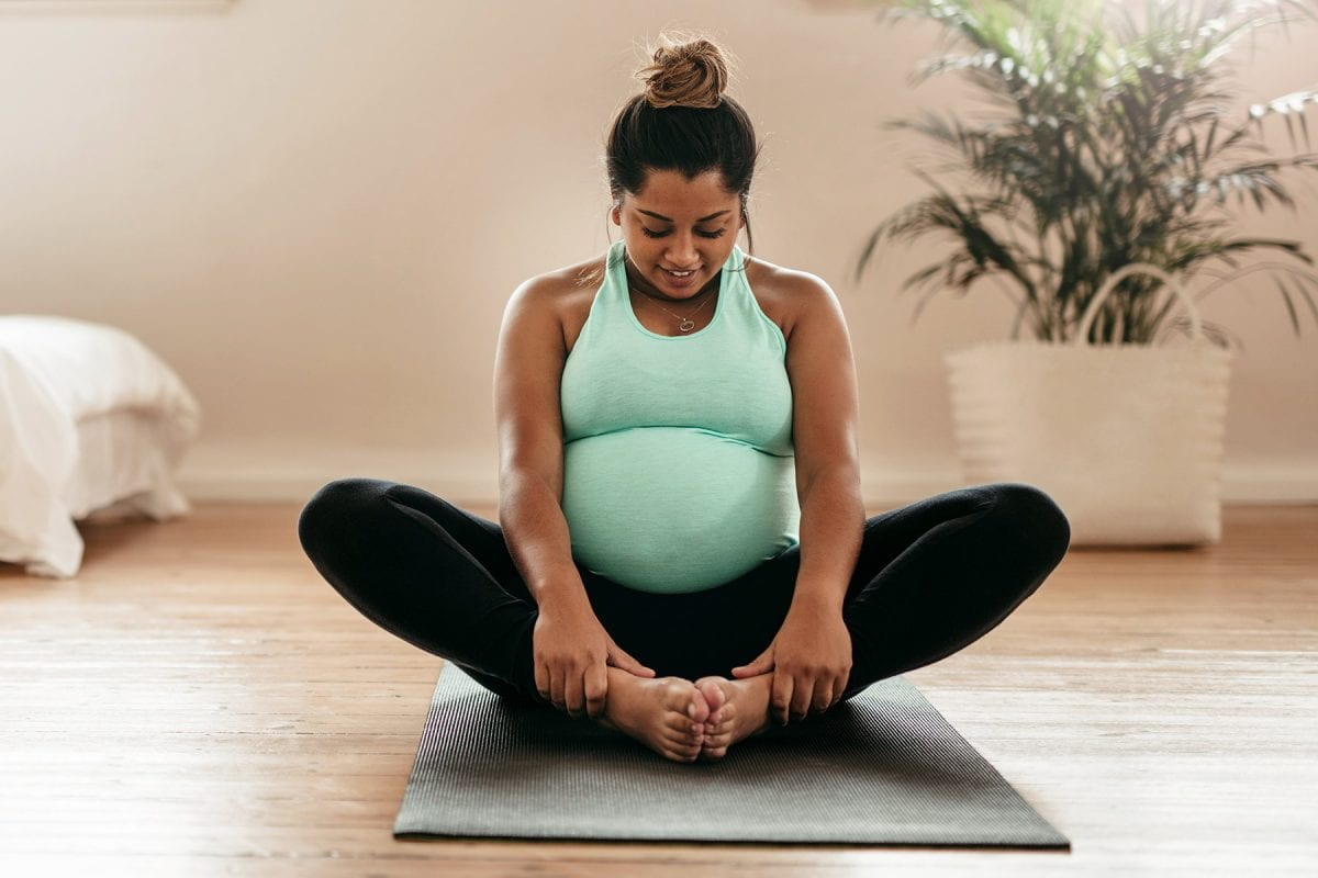 a pregnant woman stretching