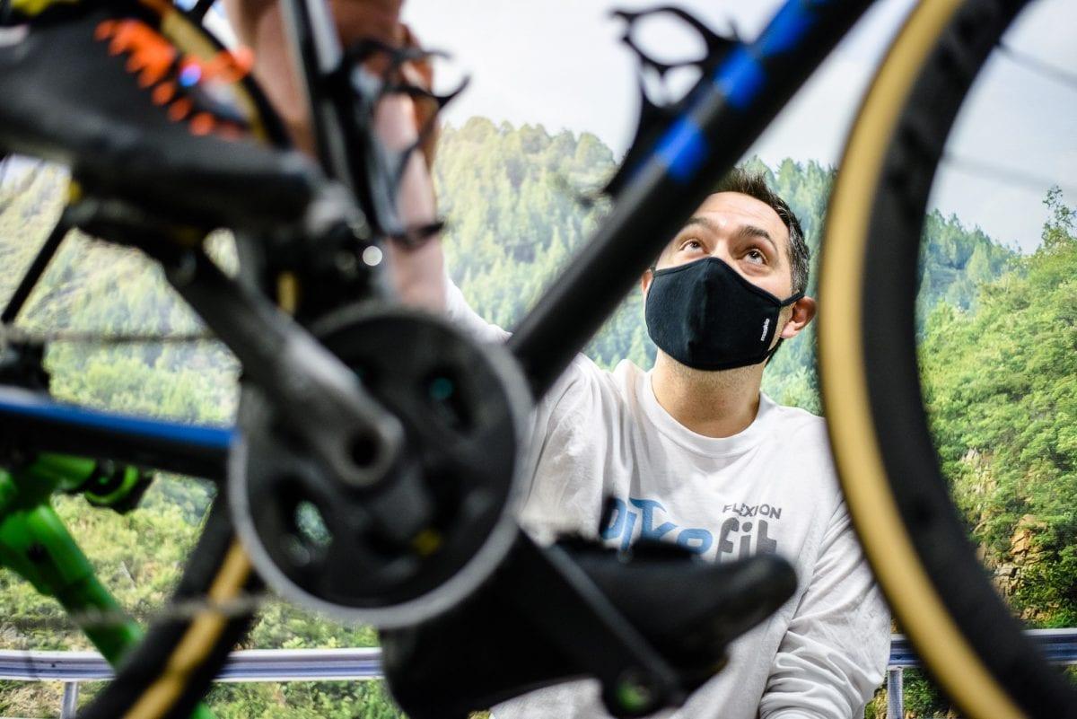 a man fitting a bike