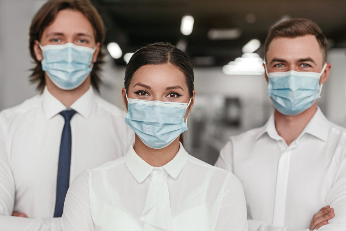 a group of masked medical professionals