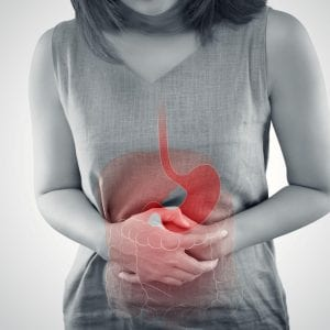 a woman holding her stomach in pain