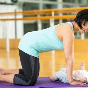a mom exercising with her baby