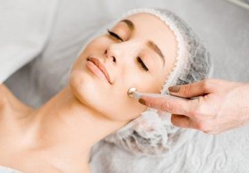 a woman receiving a facial