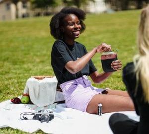 a couple women having a picnic
