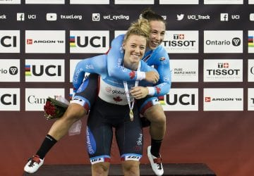 a pair of cyclists celebrating