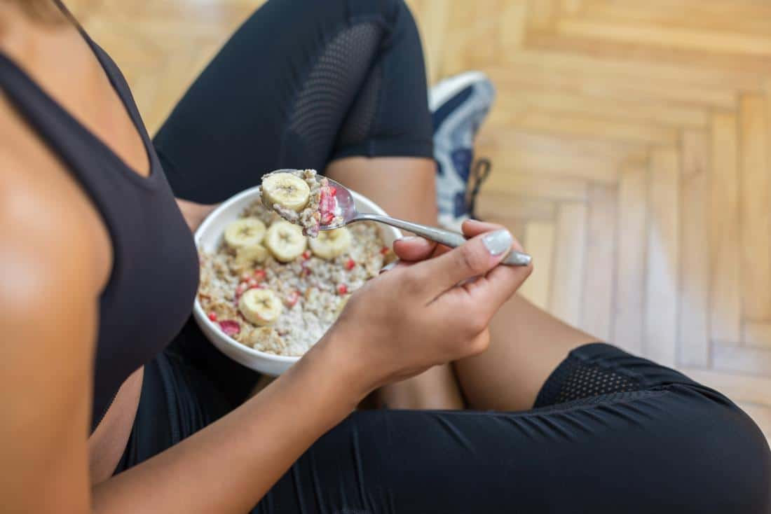 a woman eating during a workout