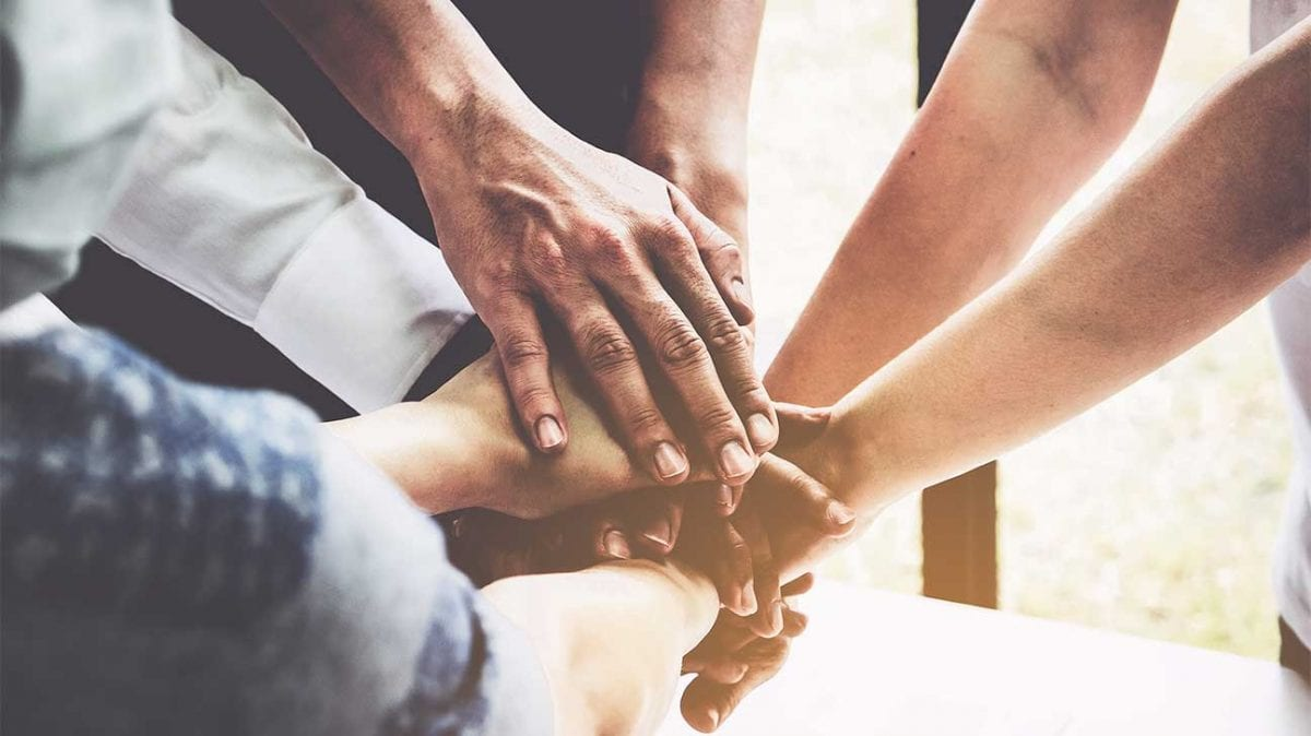 a group of people holding hands