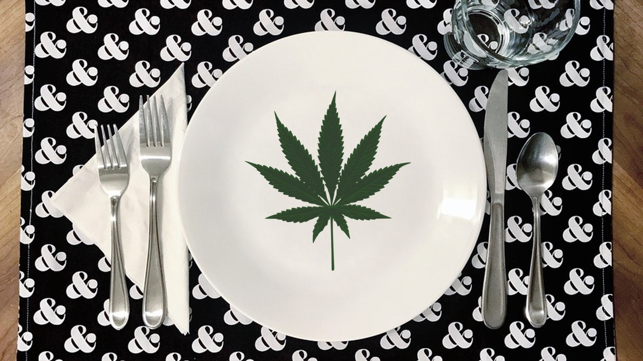 a cannibis leaf on a plate