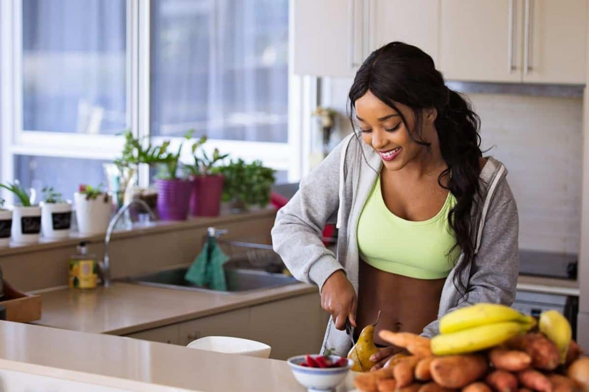 a woman cutting up healthy food