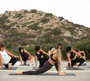 a group of people doing yoga outdoors