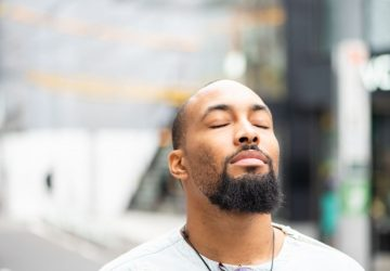 a man closing his eyes