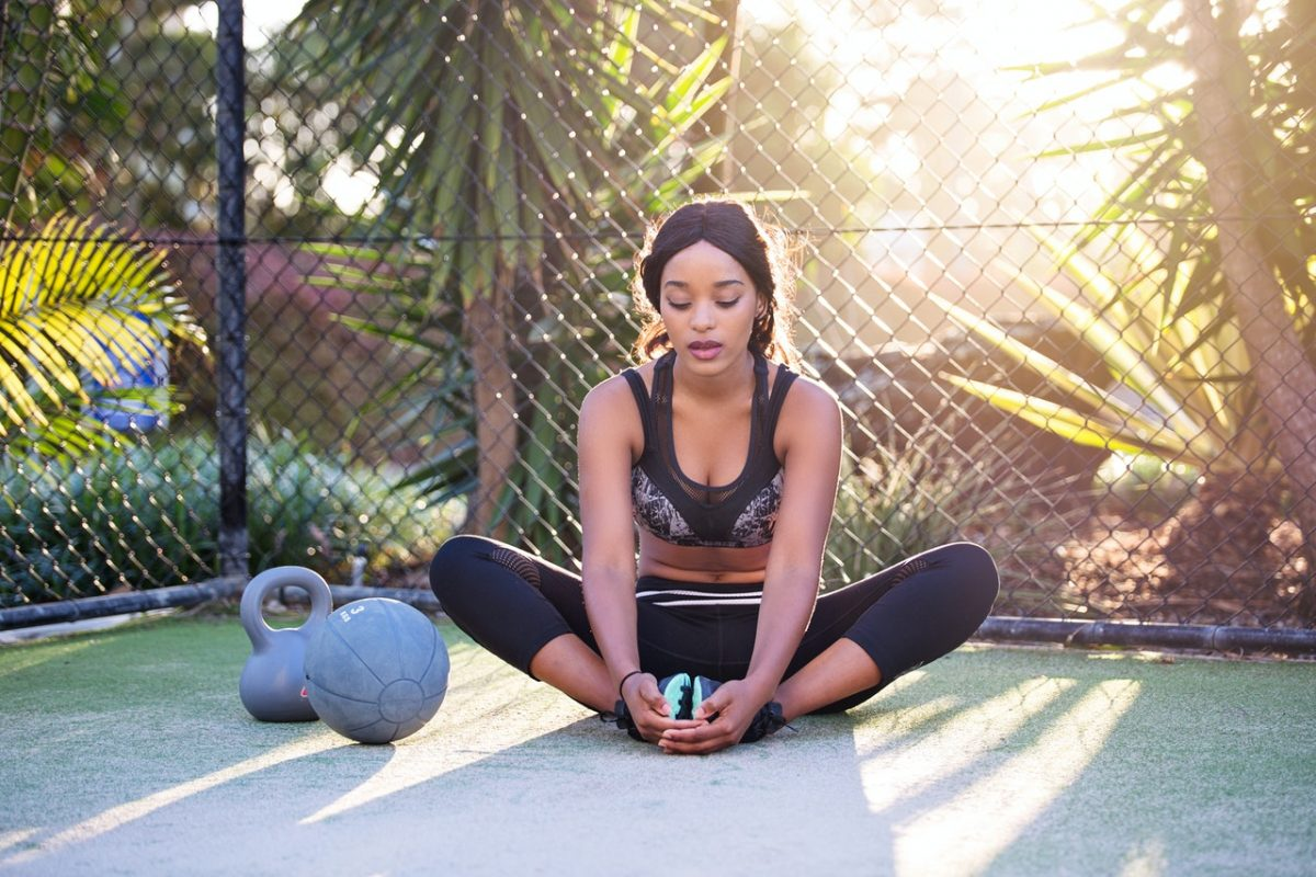 a woman stretching outdoors